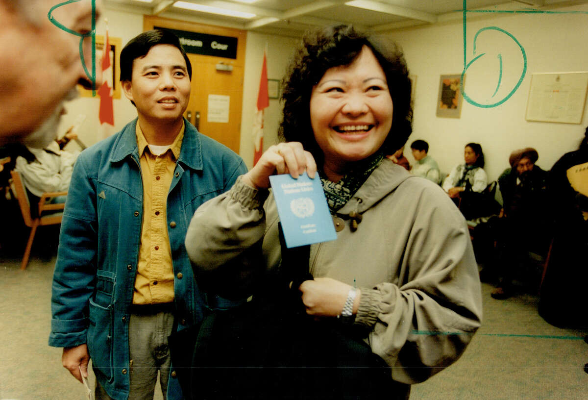 FILE--Kim Phuc and husband Toan. She was the little girl, burned by napalm, seen running and screaming in pain in a Vietnam war picture that shocked the world.