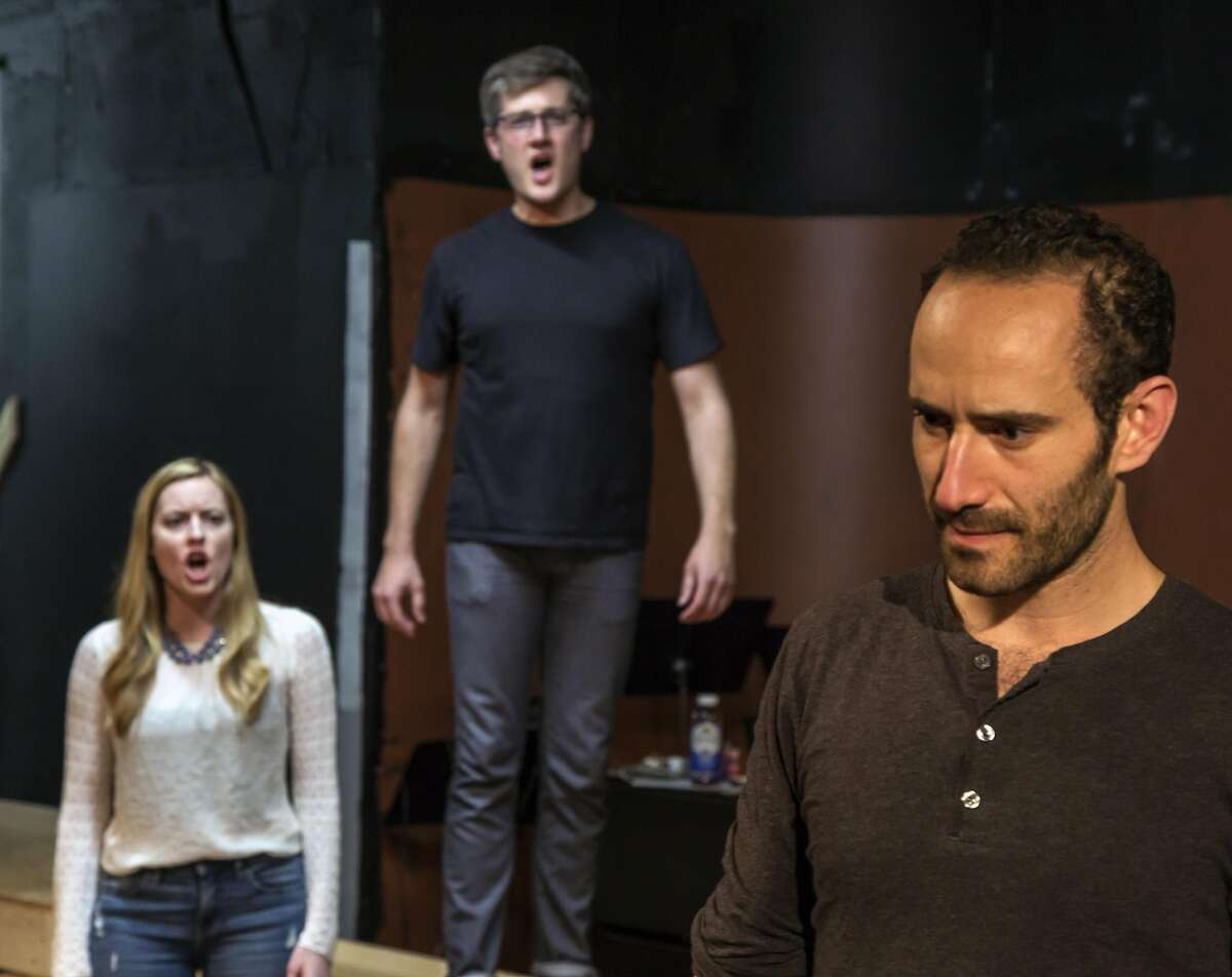 """Leah Shesky (left), Chris Uzelac and Mischa Stevens in rehearsal for """"Chess"""" at Custom Made Theatre Company."""