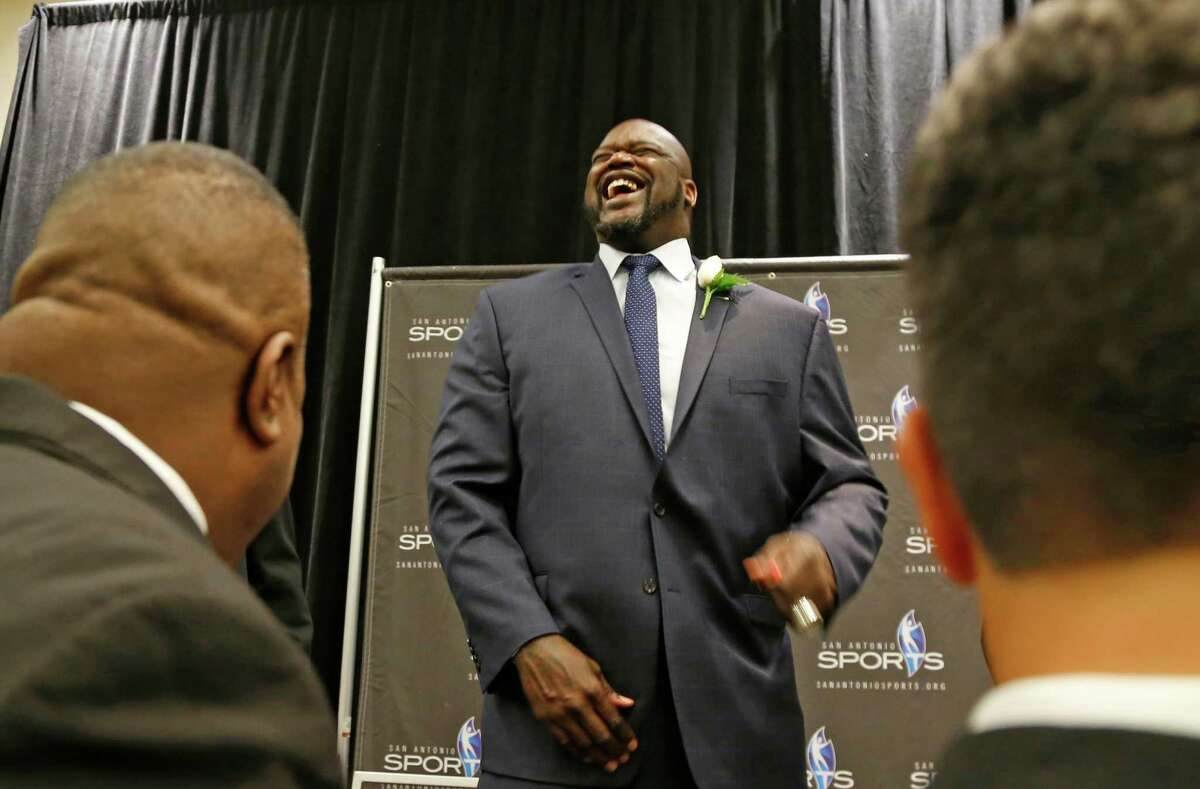 ]ADVANCE FOR USE MONDAY, MARCH 7 - In this photo taken Saturday, Feb. 27, 2016, former NBA basketball player Shaquille O'Neal jokes jokes with teammates from his 1988 Cole High School basketball team at the 2016 San Antonio Sports Hall of Fame induction ceremony in San Antonio, Texas. Thirty years after that memorable season, the 1988-89 Cole Cougars and the team's iconoclastic center, Shaq Fu, The Big Diesel, The Big Cactus, The Big Aristotle, has been inducted into the San Antonio Sports Hall of Fame. (Ronald Cortes/The San Antonio Express-News via AP) RUMBO DE SAN ANTONIO OUT; NO SALES; MANDATORY CREDIT