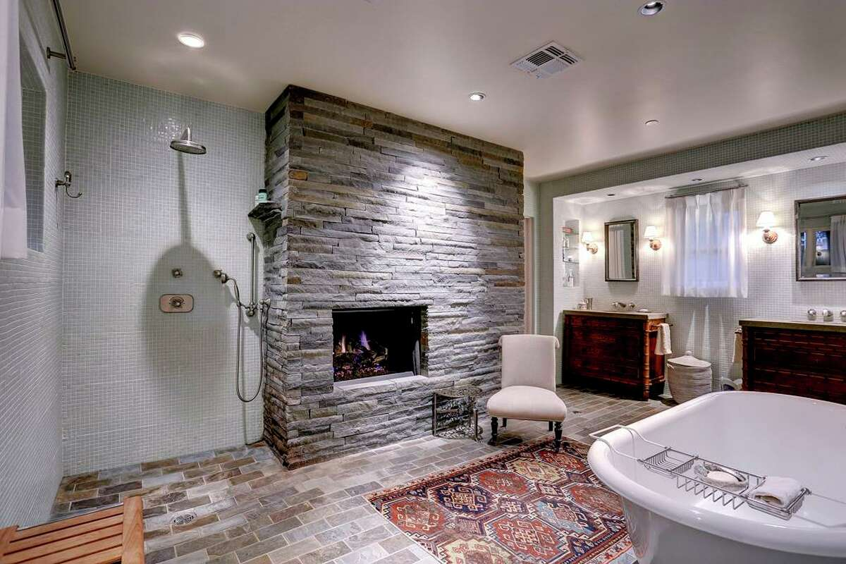 A Houston house on sale for $1.4 million features an open shower and a fireplace in the master bathroom.