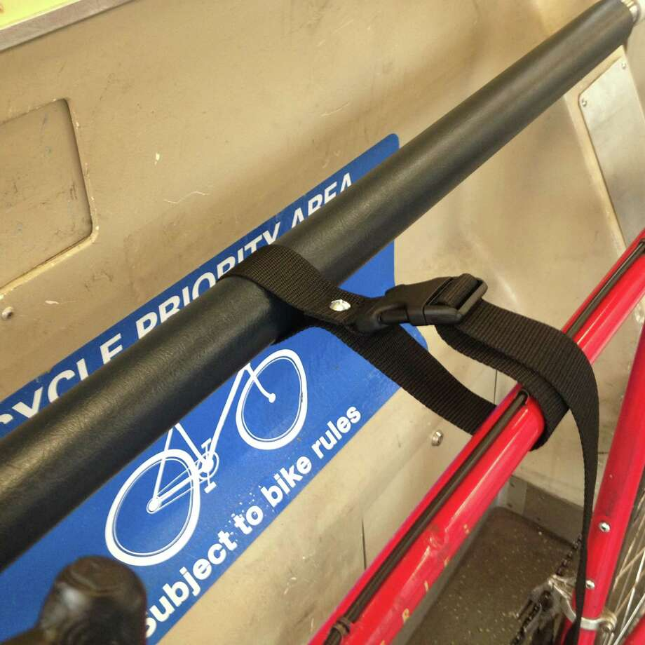 Straps are used to hold a bike upright in a new BART test program. Photo: BART / BART