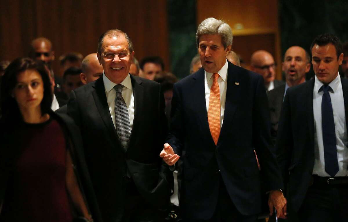 US Secretary of State John Kerry (R) and Russian Minister for Foreign Affairs Sergei Lavrov (L) speak as they arrive prior to a meeting to discuss the Syrian crisis on September 9, 2016, in Geneva. The United States and Russia will make a fresh bid to end the bloodshed in Syria on September 9, 2016 as Moscow-backed regime forces make new advances against rebel fighters on the ground. US Secretary of State John Kerry flew into Geneva for crunch talks with his Russian counterpart Sergei Lavrov, with Washington warning talks could not go on forever without a breakthrough. The two powers back opposite sides in the five-year conflict, with Moscow supporting the regime of President Bashar al-Assad and the US behind the rebels. / AFP PHOTO / POOL / KEVIN LAMARQUEKEVIN LAMARQUE/AFP/Getty Images