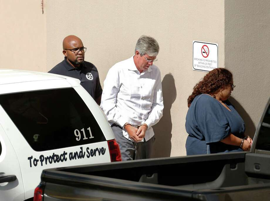 Tim Duncan's former financial adviser, Charles Banks, is transported to federal court early Friday morning after he turned himself in on federal charges. Banks was apparently indicted this week in connection with allegations that he duped Duncan into making certain investments, losing between $1.1 million and $25 million of Duncan's money on Friday, September 9, 2016. Photo: Ron Cortes, Freelance / For The San Antonio Express-News