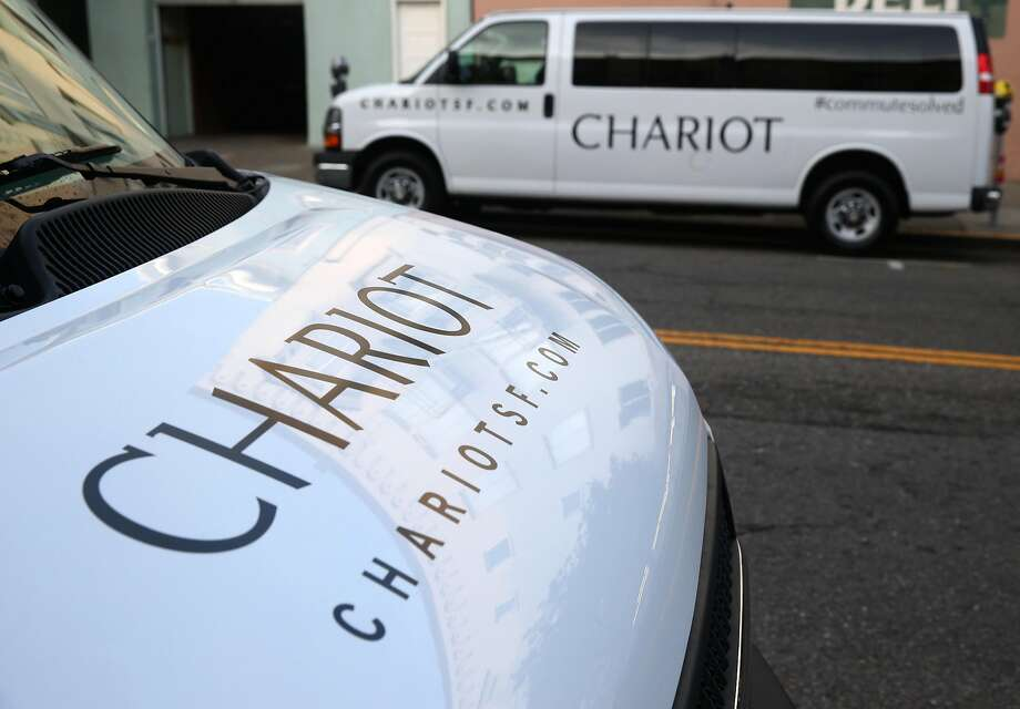 Chariot commuter vans wait to start their runs in the staging area at Divisadero and Chestnut streets in San Francisco, Calif. on Tuesday, March 17, 2015. Photo: Paul Chinn, The Chronicle