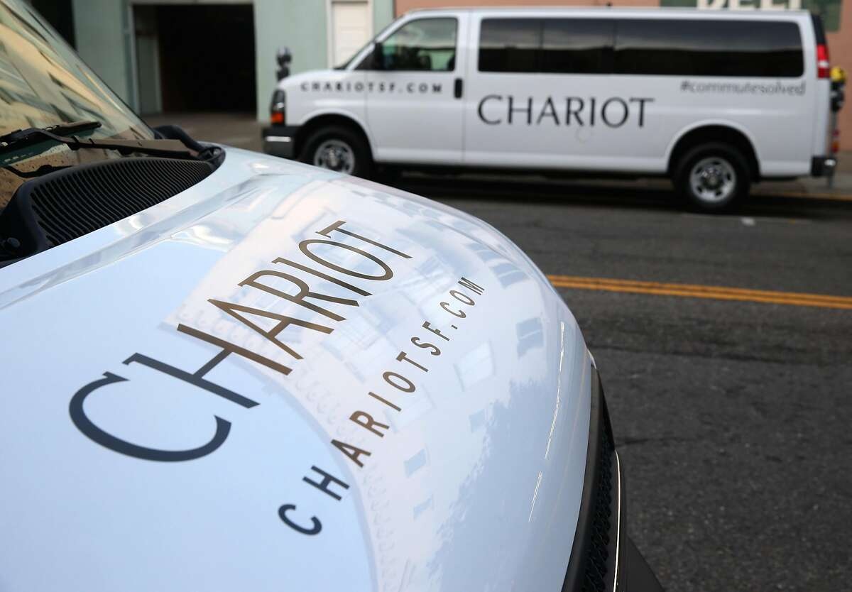 Chariot commuter vans wait to start their runs in the staging area at Divisadero and Chestnut streets in San Francisco, Calif. on Tuesday, March 17, 2015.