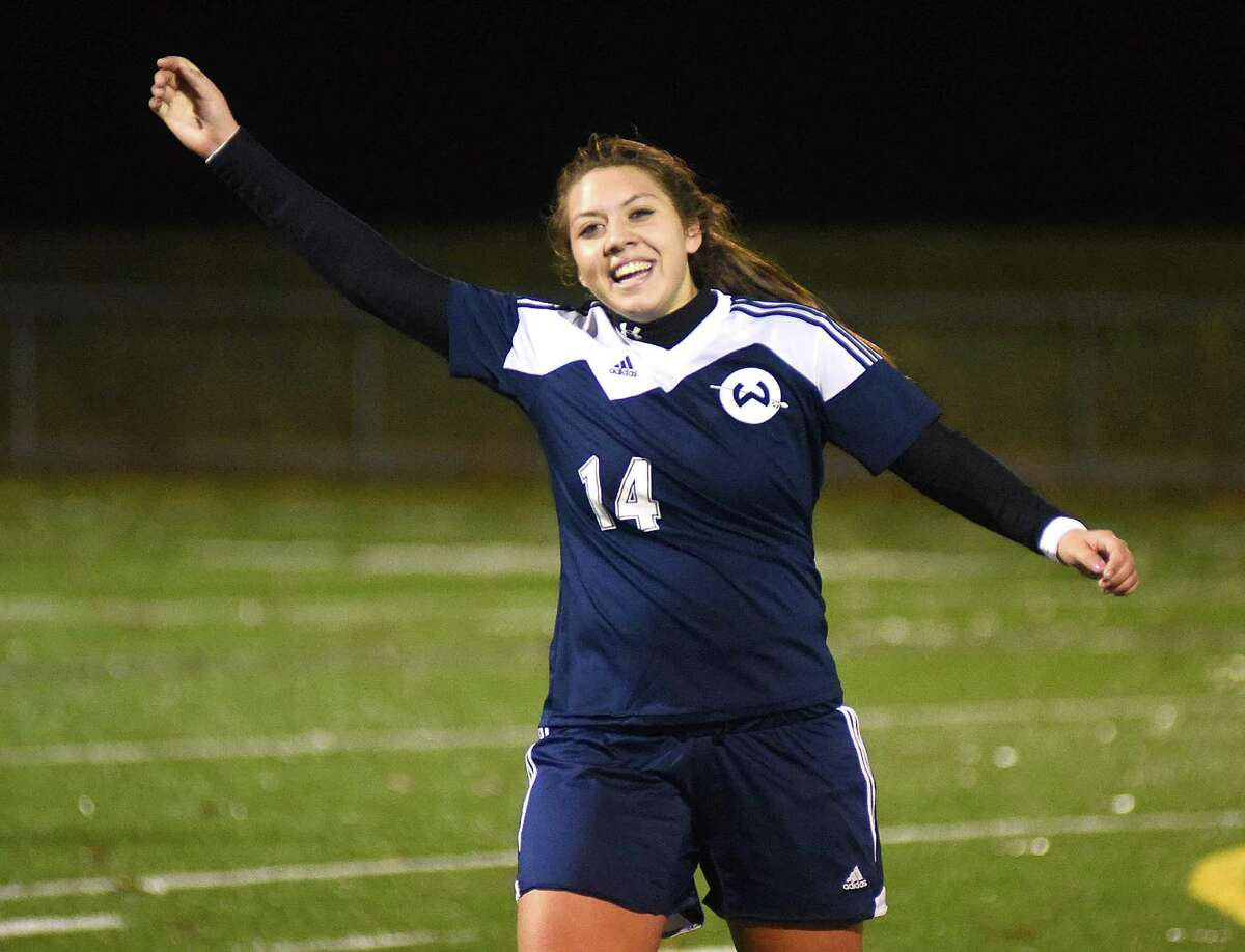 Wilton's Andrea Benalcazar hopes her Warriors will once again be all smiles this season. postseason double-overtime win over Newington.