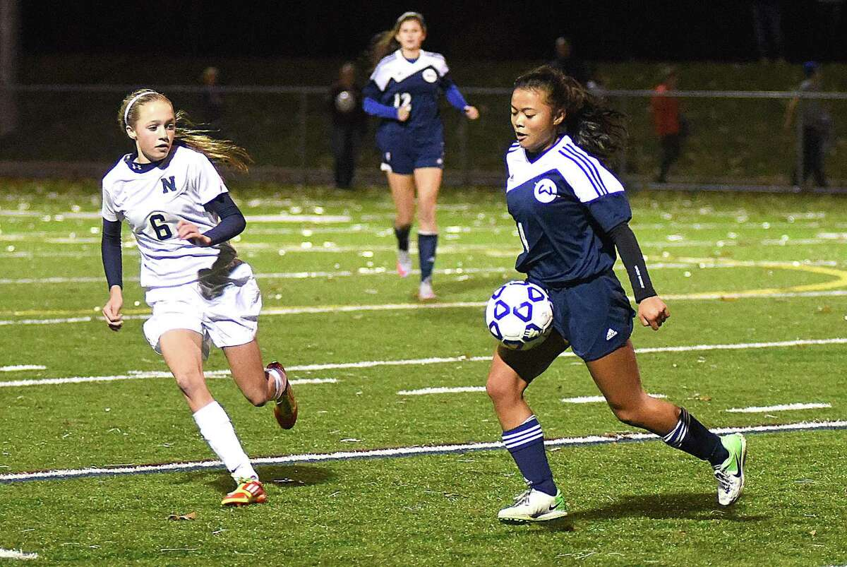 Wilton's Bria Albanese, right, is one of the team's seven key returning seniors.