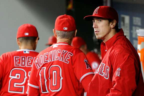 Los Angeles Angels starting pitcher Tim Lincecum stands in the dugout after being pulled from a baseball game against the Seattle Mariners, Friday, Aug. 5, 2016, in Seattle. (AP Photo/Ted S. Warren)