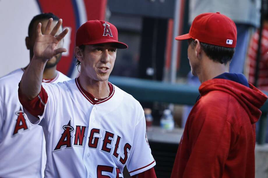 FILE-- Los Angeles Angels pitcher Tim Lincecum talks with pitching coach Charles Nagy after finishing his first inning against the Texas Rangers in a baseball game Tuesday, July 19, 2016, in Anaheim.  Photo: Lenny Ignelzi, Associated Press