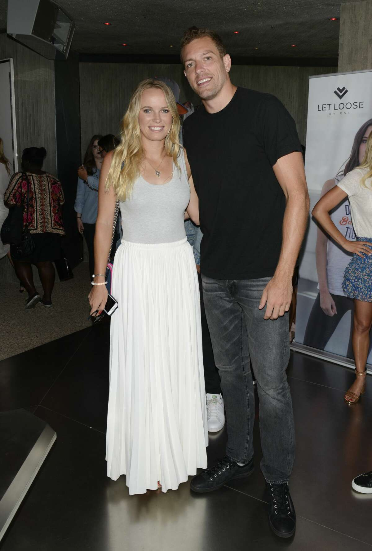 LOS ANGELES, CA - JULY 12: Tennis Player Caroline Wozniacki (L) and NBA Player David Lee attend 2016 ESPYs Talent Resources Sports Luxury Lounge on July 12, 2016 in Los Angeles, California. (Photo by Michael Bezjian/Getty Images for Talent Resources Sports)