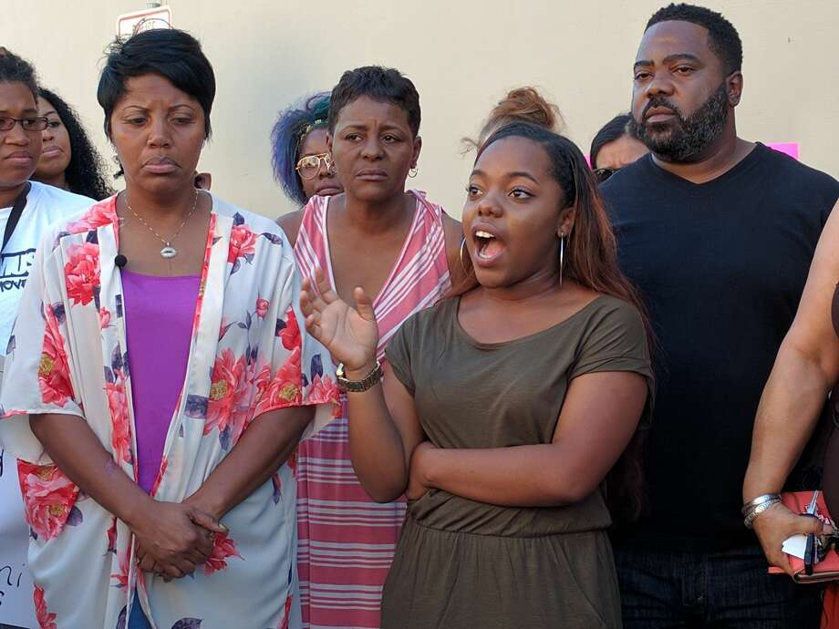 Vanae Wright and Leilani Green are joined by family and community members Thursday, September 8, 2016, outside the Bexar County Sheriff's Office as they discuss the details of their arrest at a Whataburger in Converse. Photo: Jacob Beltran/San Antonio Express-News