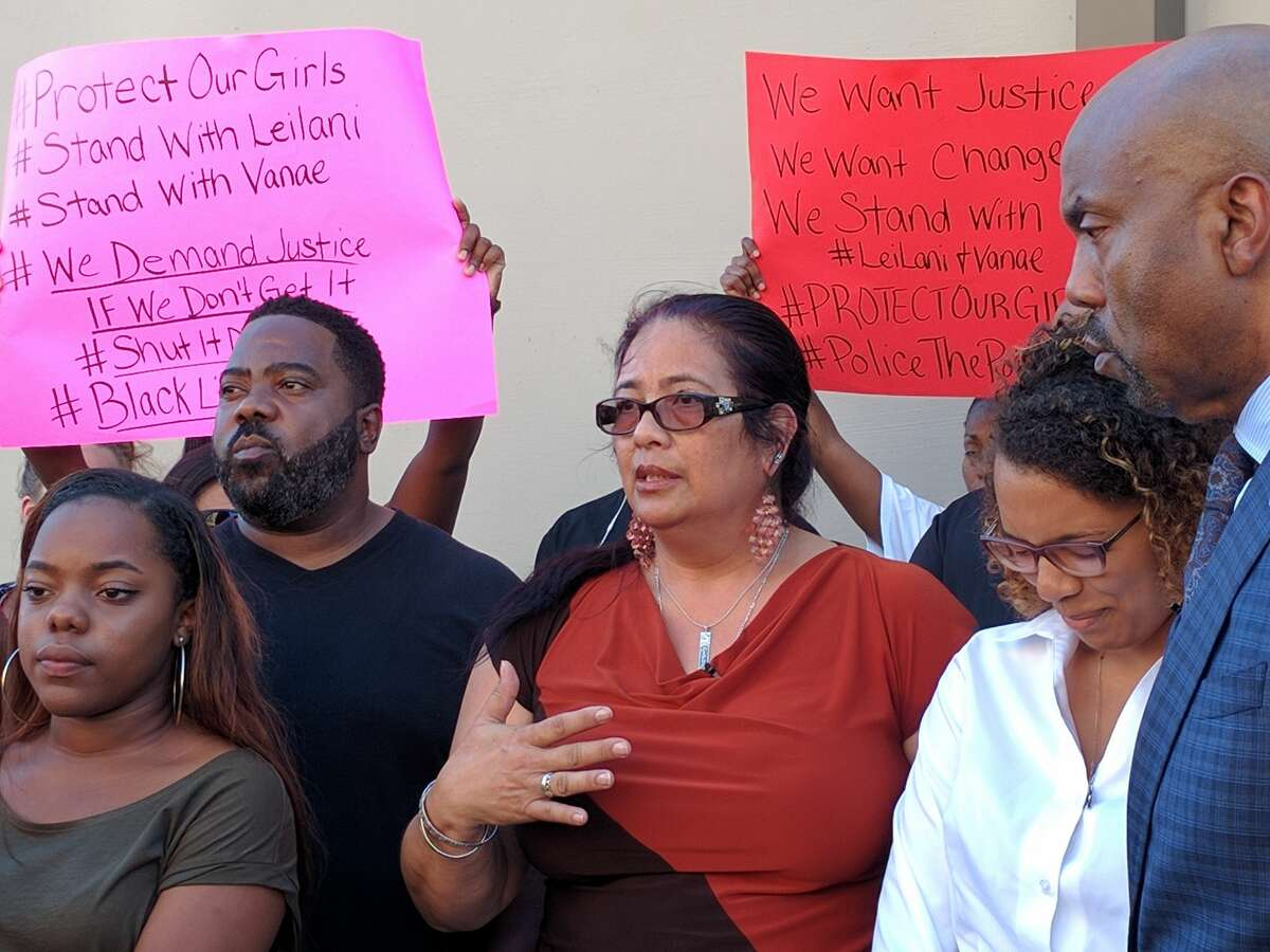 Vanae Wright and Leilani Green are joined by family and community members Thursday, September 8, 2016, outside the Bexar County Sheriff's Office as they discuss the details of their arrest at a Whataburger in Converse.