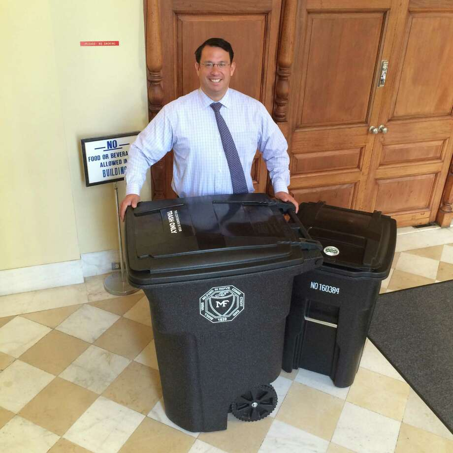 Mayor Benjamin Blake of Milford, Connecticut, is seen here in the lobby of City Hall on Sept. 7, 2016, with the the new Toter-style garbage bins that the city will begin using beginning Oct. 31. Homes will be issued the larger, 96-gallon trash can, but homeowners can select the smaller 48-gallon bin if they want. Photo: John Burgeson / Connecticut Post