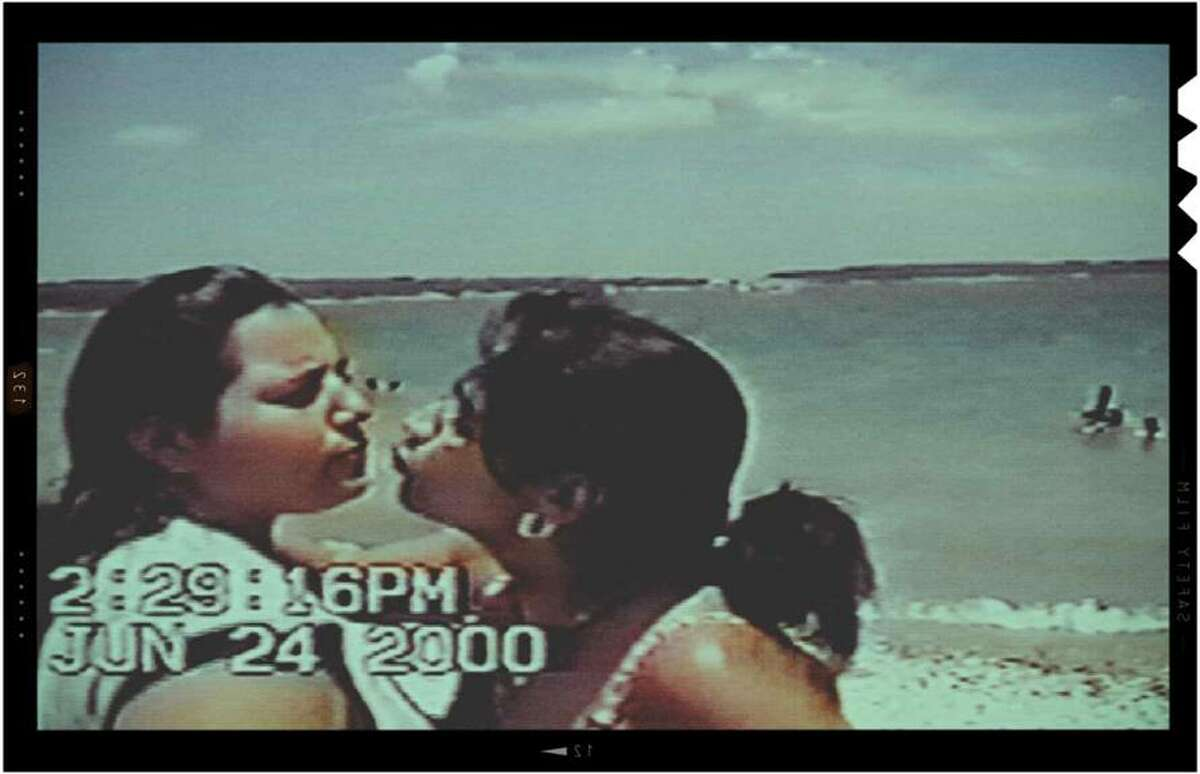 """In """"Southwest of Salem: The Story of the San Antonio Four,"""" a home movie shows Anna Vasquez and Cassandra Rivera sharing a tender moment at Canyon Lake shortly before they had to report to prison."""