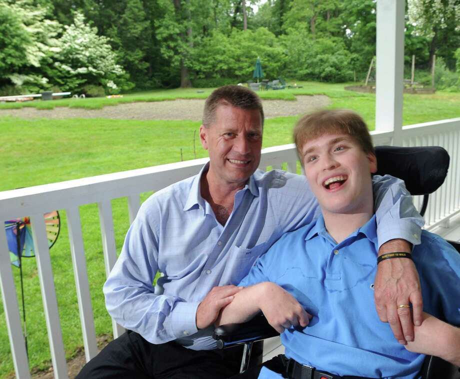 Fred Trump with his son, William at their Greenwich home in 2013. William Trump has cerebal palsy and Fred Trump will again be hosting the Golf for Abilis benefit at the Trump National Golf Course in Briarcliff Manor, N.Y., on Sept. 26. Photo: Bob Luckey / Bob Luckey / Greenwich Time