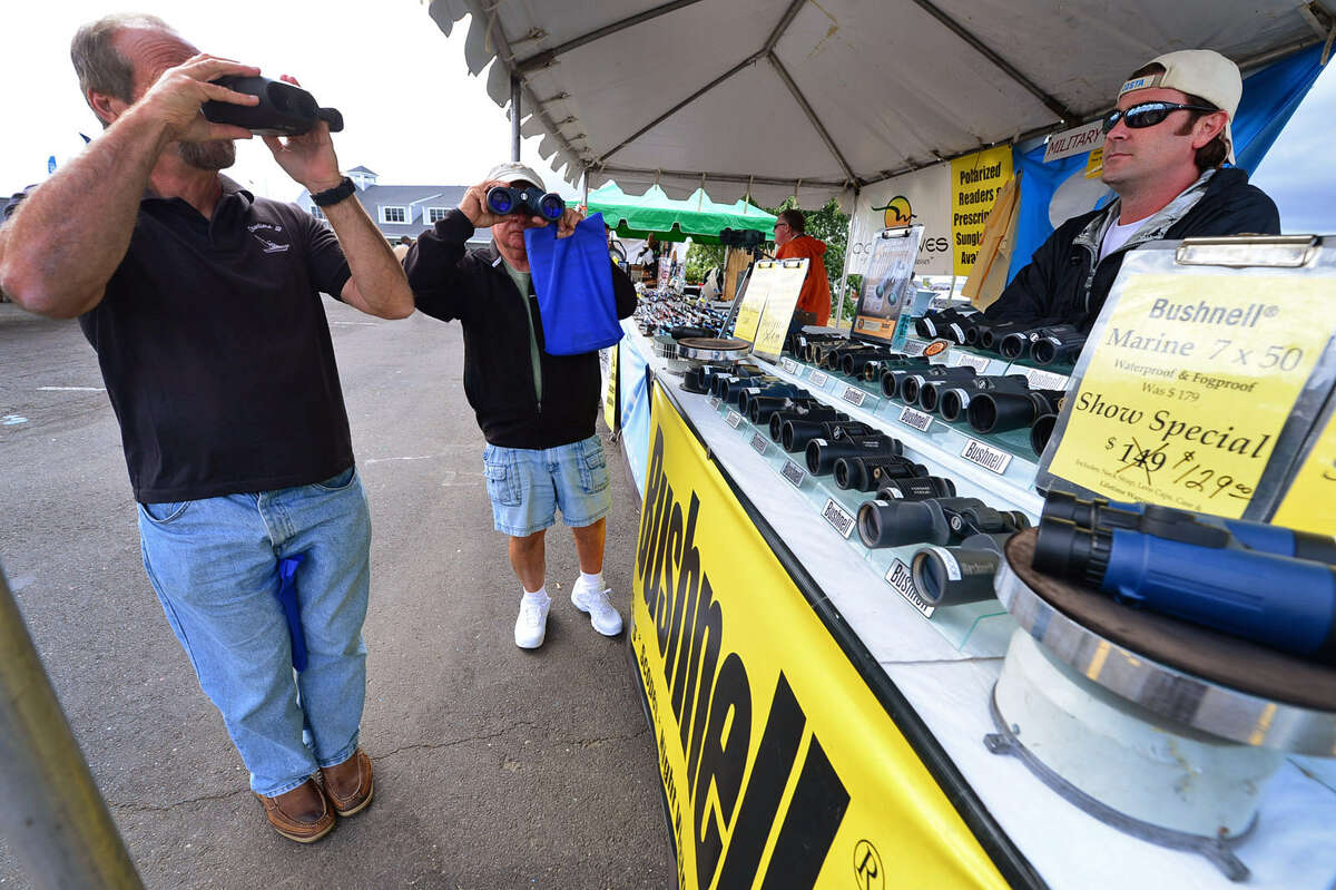 Visitors eyeball Shark Tested Optics binoculars at the 2012 Norwalk Boat Show, with the 2016 installment scheduled for September 22-25 in Norwalk, Conn.