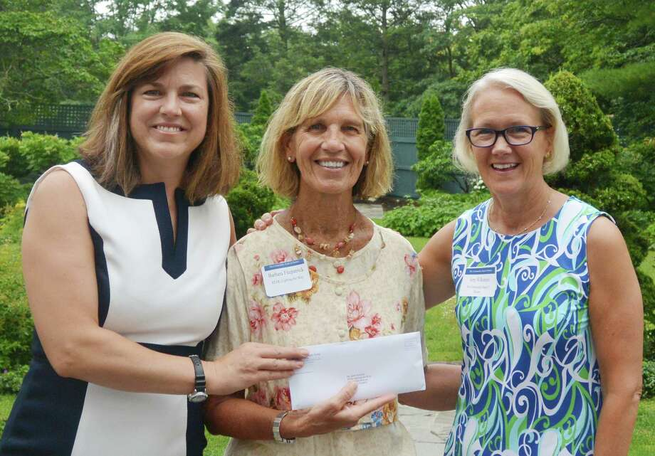 Carrie Bernier and Amy Wilkinson from The Community Fund of Darien present a grant to Barbara Fitzpatrick, director of STAR's Rubino Family Center and Birth to Three Program. Darien, Conn. Sept. 2016. Photo: Contributed / Contributed Photo