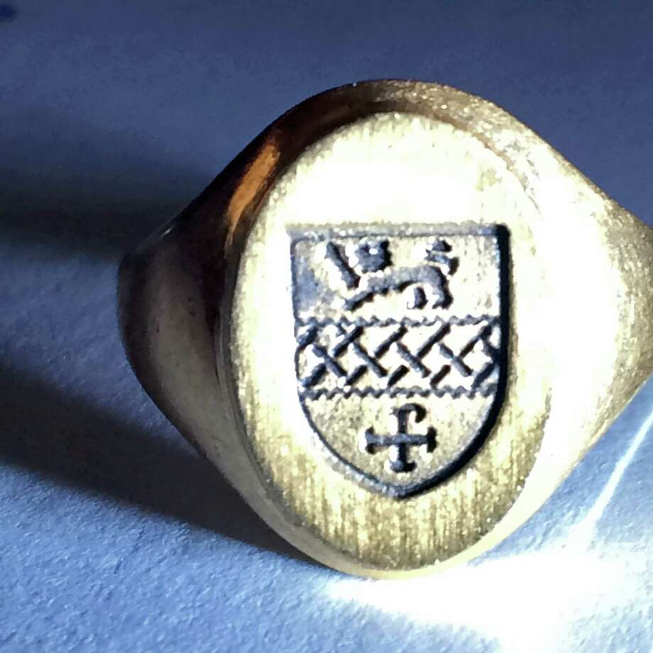 Officer Tony Krushinski found this gold class ring while using his metal detector on Southport Beach recently. He was able to track down its owner, Andrea Sievert, a1981 graduate of the Kent School. Fairfield, CT. 9/7/16 Photo: Contributed Photo / Hearst Connecticut Media / Fairfield Citizen contributed
