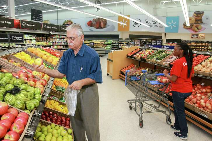 Bob Baktash shopping in the produce department at the newly remodeled Walmart Supercenter located at 2700 South Kirkwood. (For the Chronicle/Gary Fountain, September 9, 2016)