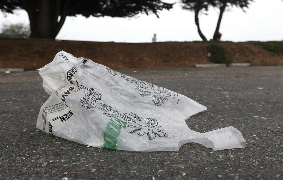 A plastic grocery bag blows across a Berkeley Marina parking lot in Berkeley, Calif. on Friday, Sept. 9, 2016. Two statewide initiatives on the November ballot, Props. 65 and 67, concern the use of plastic grocery bags. Photo: Paul Chinn, The Chronicle