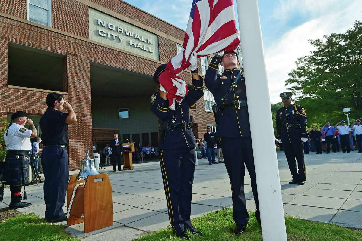 The Norwalk Police Department Honor Guard post the colors during Norwalk?'s annual 9-11 Remembrance Friday, September 9, 2016, in the plaza in front of City Hall in Norwalk, Conn.