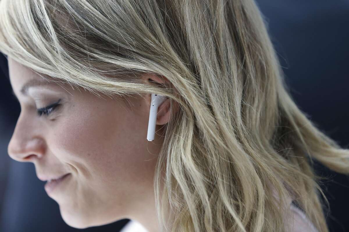 SAN FRANCISCO, CA - SEPTEMBER 07: An attendee wears an Apple AirPods during a launch event on September 7, 2016 in San Francisco, California. Apple Inc. unveiled the latest iterations of its smart phone, the iPhone 7 and 7 Plus, the Apple Watch Series 2, as well as AirPods, the tech giant's first wireless headphones. (Photo by Stephen Lam/Getty Images)