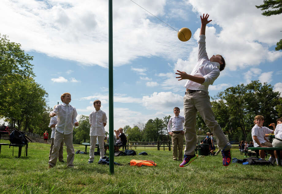 Sixth grader Carson Miles leaps for the tether ball during the Stanwich School's annual Welcome Back Picnic and Triskelion Cup Kickoff at the Stanwich School in Greenwich, Conn. on Friday, September 9, 2016. Photo: Chris Palermo / For Hearst Connecticut Media / Greenwich Time Freelance