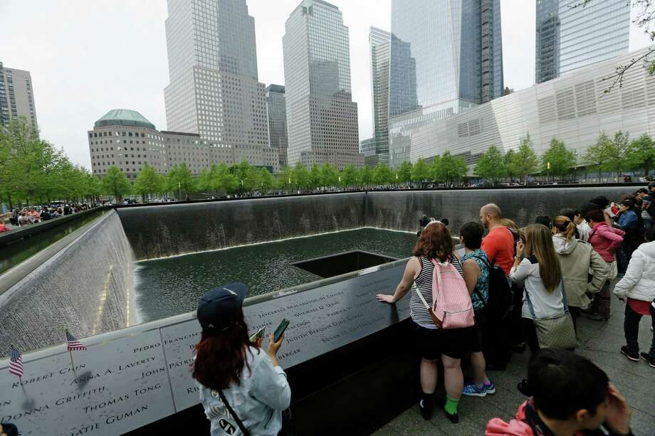 Patrons visit the pools at The 9/11 Memorial near the World Trade Center in New York in May 2014. Fifteen years after the Sept. 11 attacks, downtown New York has been reborn, not just with the construction of One World Trade, but with a host of attractions both somber and vibrant, including the 9/11 Memorial and Museum, two retail malls, new hotels and restaurants. Photo: Frank Franklin II /AP / Copyright 2016 The Associated Press. All rights reserved. This material may not be published, broadcast, rewritten or redistribu