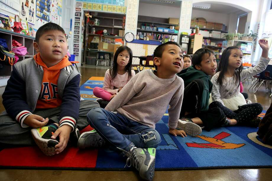 Front left to right--Frankie Li, Aaron Ko, Tramas Thongnopnia, and Olivia Chau, all 6 years old, listen to their teacher in a Cantonese immersion classroom at West Portal School on Friday, September 9, 2016, in San Francisco, Calif.  A statewide ballot measure would change the law to make it easier for children to access bilingual education. Photo: Liz Hafalia, The Chronicle
