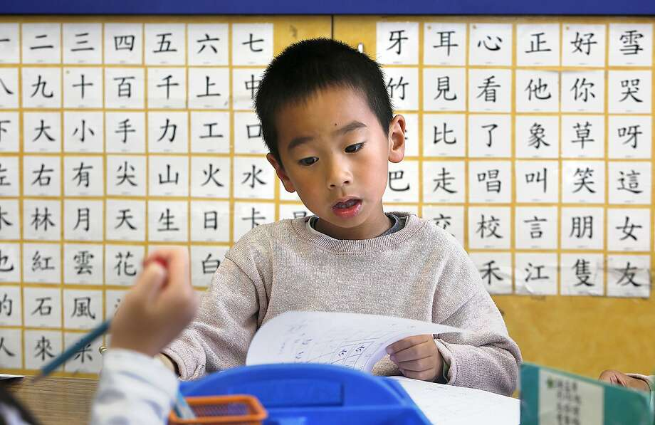 Student Aaron Ko (middle), 6 years old, studies in a Cantonese immersion classroom at West Portal School on Friday, September 9, 2016, in San Francisco, Calif.  A statewide ballot measure would change the law to make it easier for children to access bilingual education. Photo: Liz Hafalia, The Chronicle