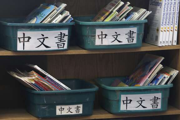 Boxes of books displayed in a Cantonese immersion class at West Portal School on Friday, September 9, 2016, in San Francisco, Calif.  A statewide ballot measure would change the law to make it easier for children to access bilingual education.