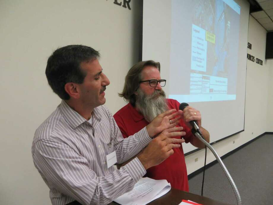 Kerrville City Councilman Gary Stork (right) tried to wrest the microphone from George Baroody, a member of The Kerrville Majority, a group formed to challenge the direction of the city under the current city council, at a town hall meeting Sept. 8, 2016. Stork's death two weeks later was ruled a suicide this week. Photo: Zeke MacCormack /Staff