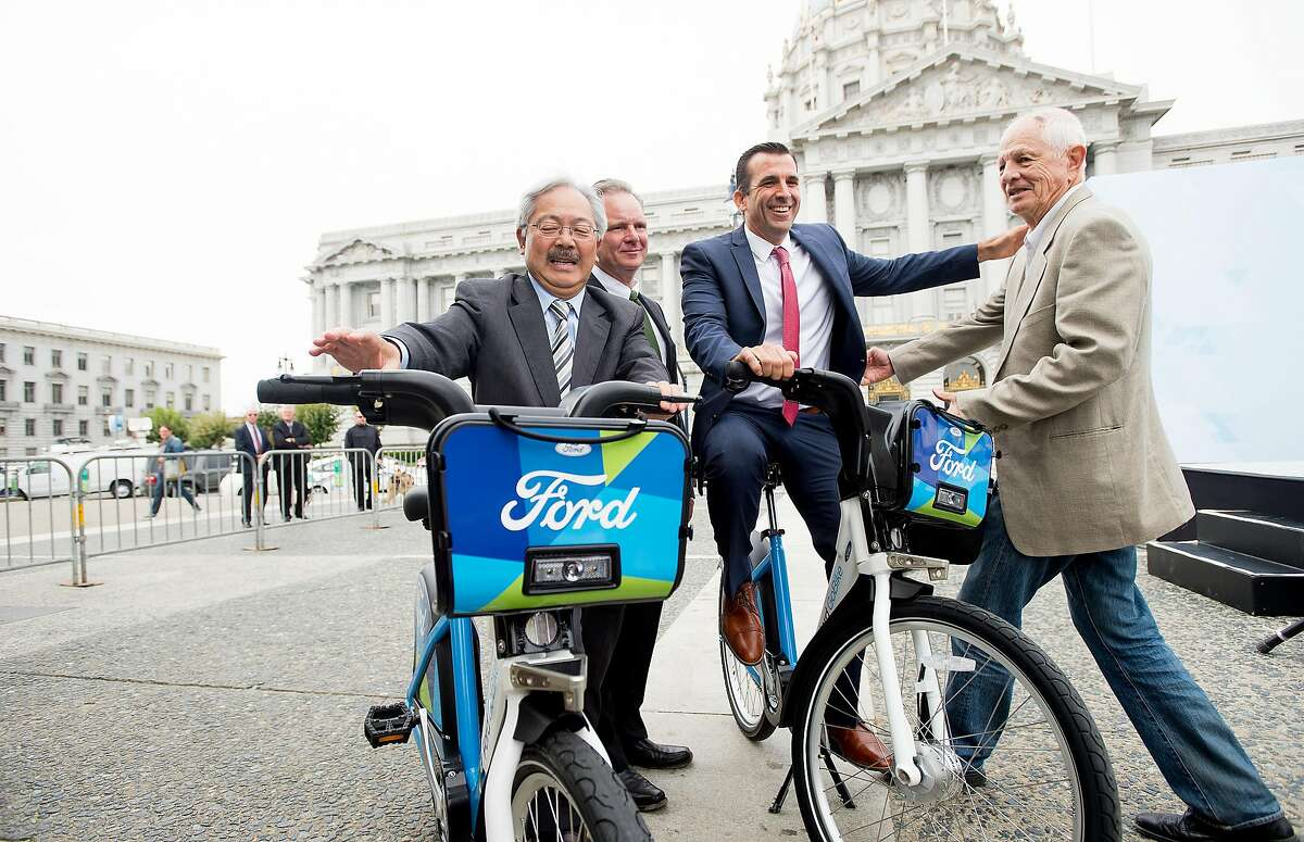 From left to right, San Francisco Mayor Ed Lee, Metropolitan Transportation Commission Chairman Dave Cortese, San Jose Mayor Mayor Sam Liccardo and Berkeley Mayor Tom Bates stand with bicycles during Ford GoBike's launch event on Friday, Sept. 9, 2016, in San Francisco.