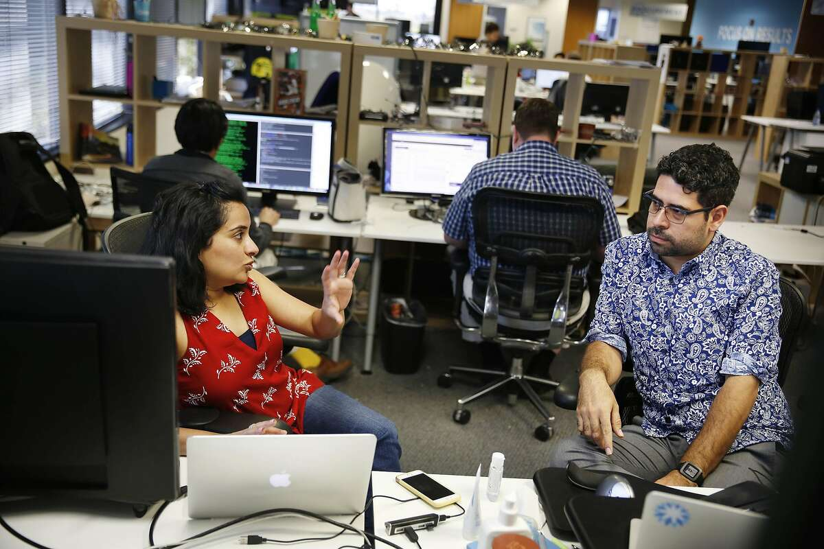 Pooja Mangla, senior manager quality engineering and Augustin Avila, senior quality engineering talk while working at Coupa headquarters on Friday, September 9, 2016 in San Mateo, California.