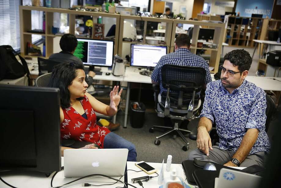 Coupa Software employees Pooja Mangla and Augustin Avila talk at Coupa Software headquarters in San Mateo. Photo: Lea Suzuki, The Chronicle