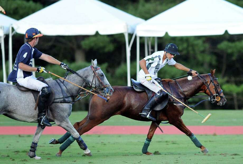 White Birch polo player Hilario Ulloa (#1), right, in action during the East Coast Open semi-final polo match between White Birch vs. Airstream at the Greenwich Polo Club, Greenwich, Conn., Wednesday, Sept. 7, 2016. White Birch defeated Airstream, 10-8, to advance to the final against Audi on Sunday, Sept. 11, gates open at 1 p.m., match at 3 p.m., at the Greenwich Polo Club. Photo: Bob Luckey Jr. / Hearst Connecticut Media / Greenwich Time