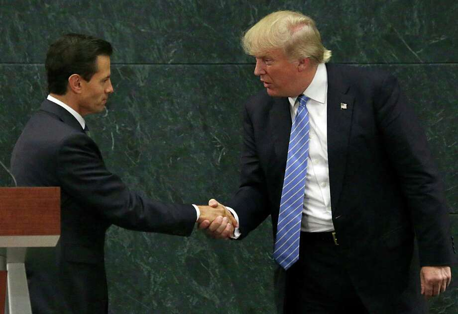 Mexican President Enrique Pena Nieto and Republican presidential nominee Donald Trump shake hands after a joint statement in Mexico City. A reader says Mexico is to blame for the immigration problem. Photo: Marco Ugarte /Associated Press / Copyright 2016 The Associated Press. All rights reserved.