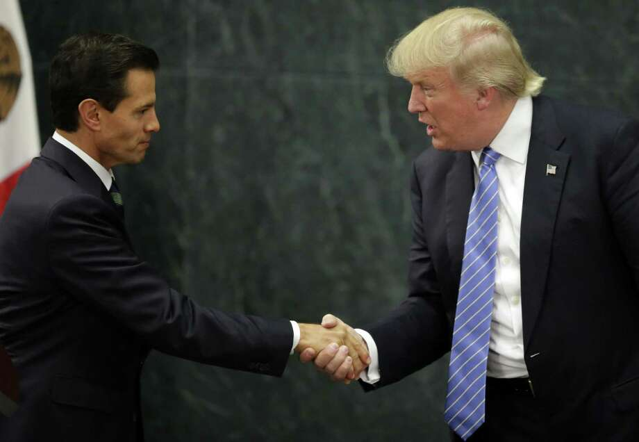 Mexican President Enrique Pena Nieto and U.S. presidential candidate Donald Trump shake hands after a meeting in Mexico City on August 31. After the meeting in Mexico City, Trump gave a speech in Phoenix, Arizona that has been unjustly castigated. Photo: YURI CORTEZ /AFP /Getty Images / AFP or licensors