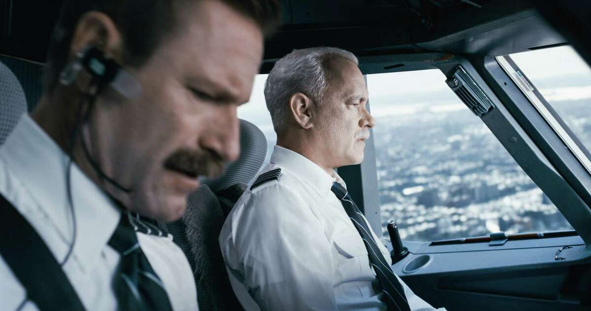 """Tom Hanks, right, and Aaron Eckhart in a scene from """"Sully."""" (Warner Bros. Pictures via AP)"""