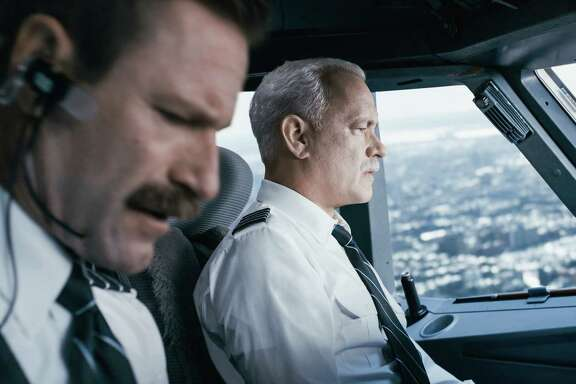 "This image released by Warner Bros. Pictures shows Tom Hanks, right, and Aaron Eckhart in a scene from ""Sully."" (Warner Bros. Pictures via AP)"