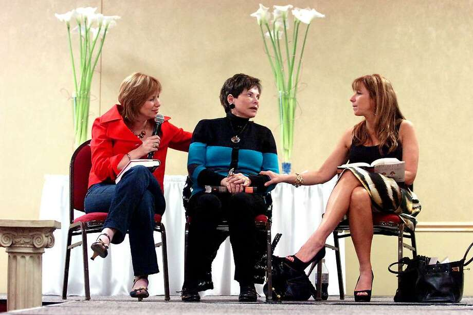"Gloria Kamen takes center stage with daughters Lisa Wexler, left, and Jill Zarin, one of the Real Housewives of New York City, during the Annual Fairfield County Women's Expo at the Stamford Plaza MAy 2, 2010. The women were on hand to discuss and sign copies of their new book ""Secrets of a Jewish Mother: Real Advice, Real Stories, Real Love."" Photo: Keelin Daly / Stamford Advocate"
