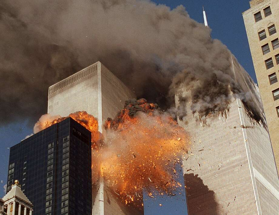 Smoke billows from one of the towers of the World Trade Center as debris explodes from the second tower on Sept. 11, 2001. Photo: CHAO SOI CHEONG, ASSOCIATED PRESS