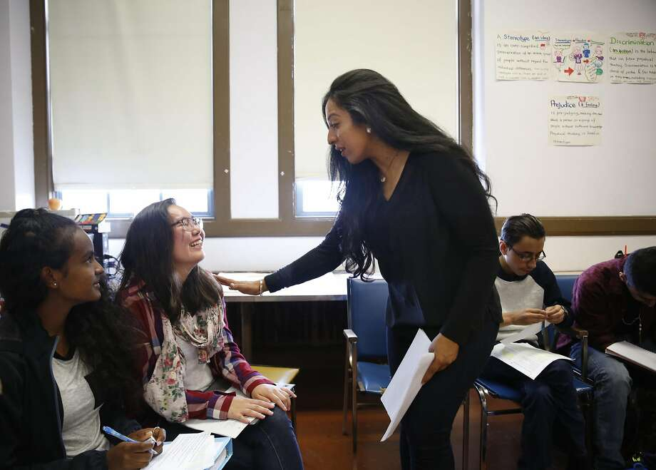 Mission High School teacher Fakhra Shah (center) talks with student Khandsuren Zandanshatar, 16, during a class Thursday on social change and critical thinking in which the students shared their thoughts about the Sept. 11 attacks. Photo: Lea Suzuki, The Chronicle