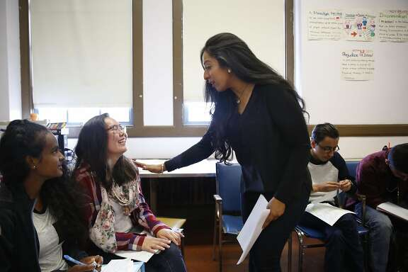 Fakhra Shah (left) talks with Khandaa Zandanshatar (second from right), 16, during  social change and critical thinking class at Mission High School on Thursday, September 8,  2016 in San Francisco, California.