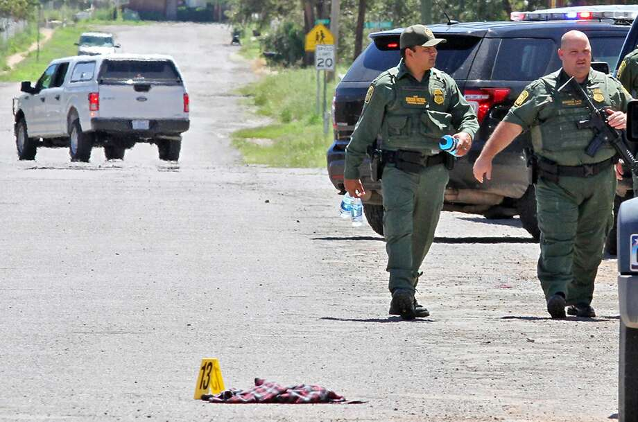 United States Border Patrol officers secure the perimeter around Alpine High School after a in-school shooting  Thursday, Sept. 8, 2016, in Alpine, Texas. 14-year-old girl died of an apparent self-inflicted gunshot wound after shooting and injuring another female student Thursday inside th school, according to the local sheriff. (Jacob Ford/Odessa American via AP) Photo: Jacob Ford, Associated Press