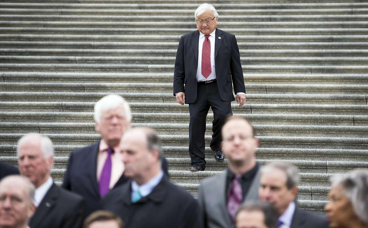 """UNITED STATES - MARCH 24: Rep. Mike Honda, D-Calif., walks down the House steps to join his colleagues for the House Democratic Caucus media event """"to commemorate the fifth anniversary of President Obama signing into law the Affordable Care Act"""" on Tuesday, March 24, 2015. (Photo By Bill Clark/CQ Roll Call)"""