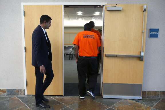 Candidate Ro Khanna follows union members into a conference room where he accepted an endorsement from plumbers, steamfitters and pipeline union Local 342 in Newark, Calif. on Sept. 7, 2016, in his bid to unseat incumbent Rep. Mike Honda in the Calif. 17th Congressional District.