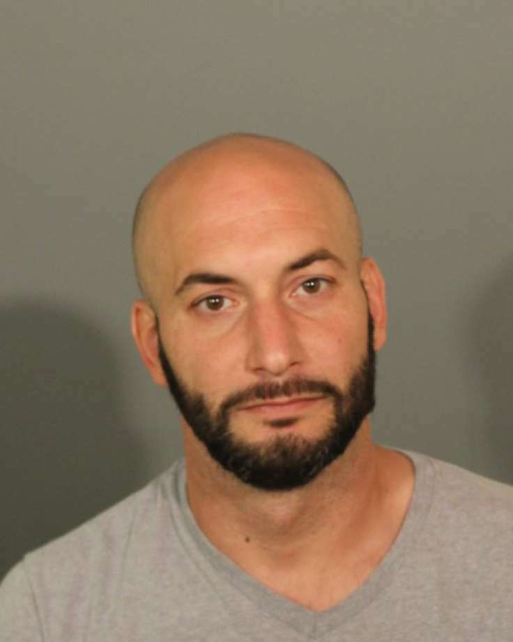 Jared Rocco Cardillo, 41, is accused of stealing a safe from a New Milford church, and burglarizing several businesses in Danbury. Photo: Contributed Photo