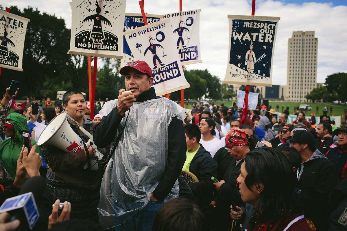David Archambault II, chairman of the the Standing Rock Sioux, speaks at a rally outside the North Dakota State Capitol in Bismarck, Sept. 9, 2016. A historic gathering of Native Americans celebrated after learning that the federal government ordered a pause in the construction of the Dakota Pipeline. (Alyssa Schukar/The New York Times)