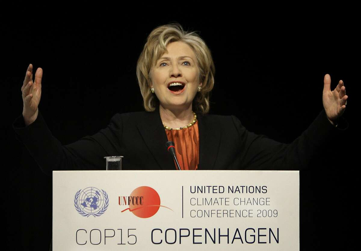 U.S. Secretary of State Hillary Clinton gestures during a press briefing at the climate summit in Copenhagen, Denmark, Thursday, Dec. 17, 2009. Clinton announced that the United States is prepared to join other rich countries in raising $100 billion in yearly climate financing for poor countries by 2020. (AP Photo/Anja Niedringhaus)